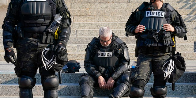 Police in riot gear stand outside the Kenosha County Court House Monday, Aug. 24, 2020, in Kenosha, Wis. Protests broke out late Sunday night after a police shooting. (AP Photo/Morry Gash)
