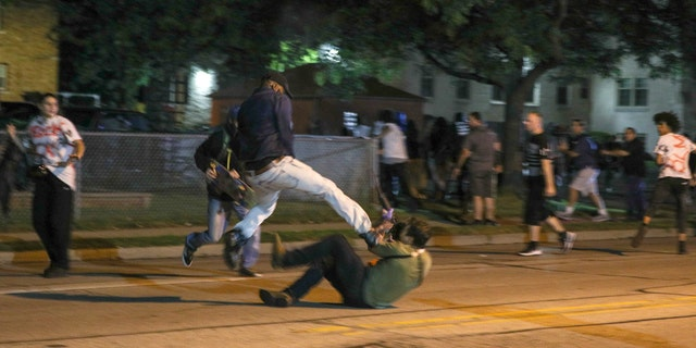 Fights breaking out during the third day of protests over the shooting of Jacob Blake in Kenosha, Wisconsin.