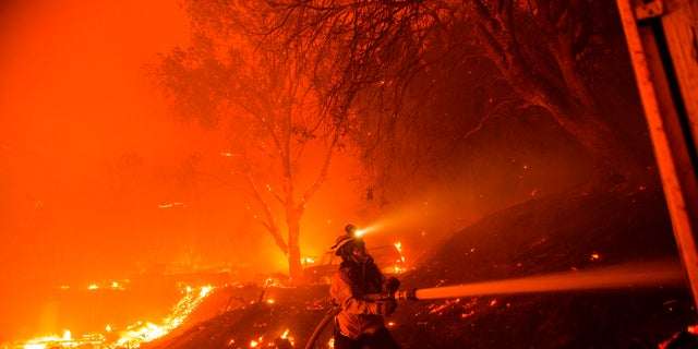 A firefighter works against the Lake Fire in Angeles National Forest on Wednesday. (AP)
