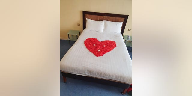 Wright had secretly planned the proposal, including laying rose petals on the bed and buying a bottle of champagne ready for Harvey to walk in.