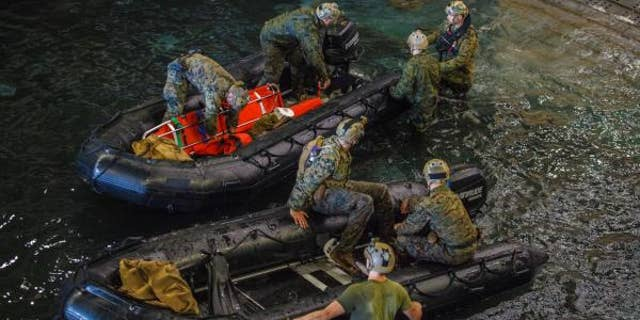 U.S. Marines and U.S. Navy sailors take part in a search for the remains of eight fellow service members off the coast of California. (15th Marine Expeditionary Unit)