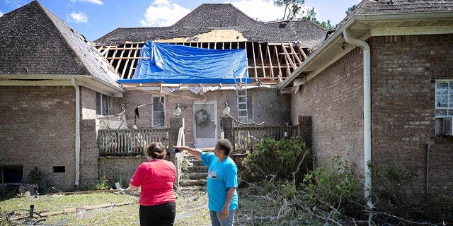 Homeowner Brenda Wilson, right, shows Cally Edwards of the American Red Cross the damage to the rear of her home on Woodard Road in rural Bertie County on Tuesday, August 4, 2020 near Windsor, N.C.