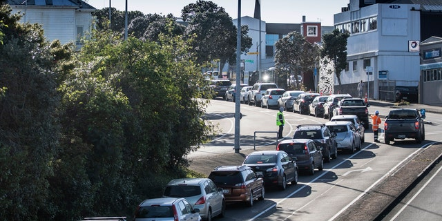 Cars line up outside the COVID-19 test center in Auckland, New Zealand, on Thursday.  (AP)