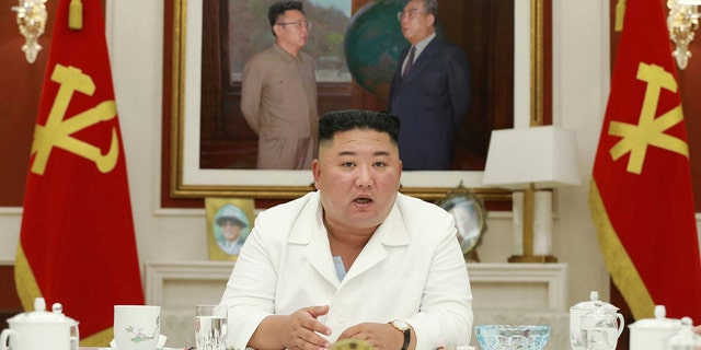 In this photo provided by the North Korean government, North Korean leader Kim Jong Un, presides over an executive policy council meeting on Aug. 5, 2020.