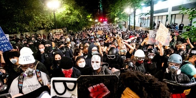 US News Black Lives Matter protesters march through Portland after rallying at the Mark O. Hatfield United States Courthouse on Sunday. (AP)