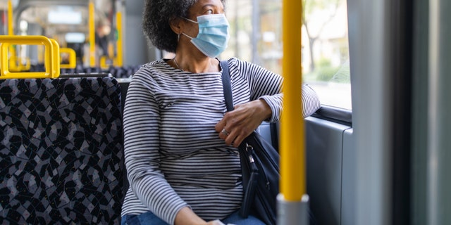 The best way to reduce the spread of an infectious disease on public transport and other places, experts say, is to wear a mask and stay 6 feet away from others.