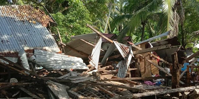 In this photo provided by the Philippine Red Cross, a toppled house is seen after a quake struck in Cataingan, Masbate province, central Philippines on Tuesday Aug. 18, 2020.