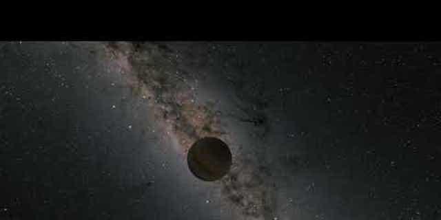 This illustration shows a rogue planet drifting through the galaxy alone. (NASA/JPL-Caltech/R. Hurt [Caltech-IPAC])