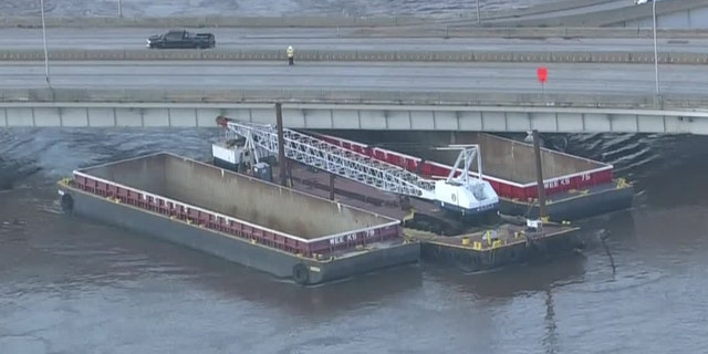 The Vine Street Expressway in Philadelphia was closed in both directions Wednesday morning due to an unsecured barge that was knocked free due to flooding from Tropical Storm Isaias.