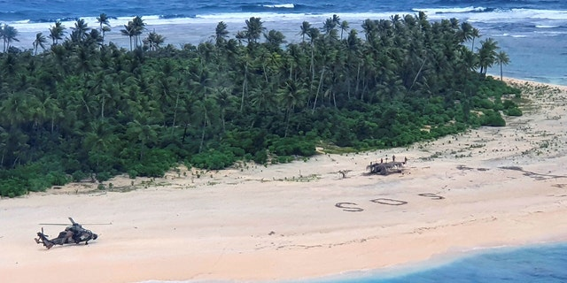 In this photo provided by the Australian Defence Force, an Australian Army ARH-90 Tiger Helicopter lands on Pikelot Island in the Federated States of Micronesia where three men were found safe and healthy on Sunday, Aug. 2, 2020, after missing for three days. (Australian Defense Force)