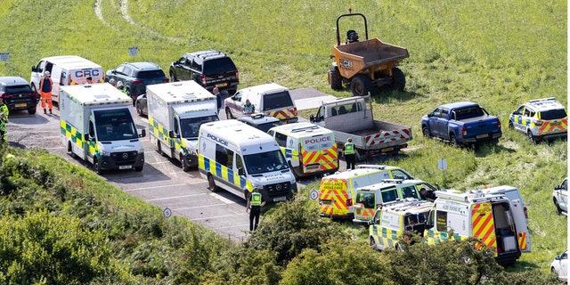 Emergency services attend the scene of a derailed train in Stonehaven, Scotland, Wednesday Aug. 12, 2020. (Derek Ironside/Newsline-media via AP)