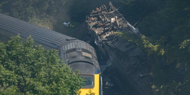 The derailed carriages were seen at the scene of the train crash near Stonehaven in northeast Scotland on August 12, 2020. (Photo by Michal Wachucik / AFP via Getty Images)