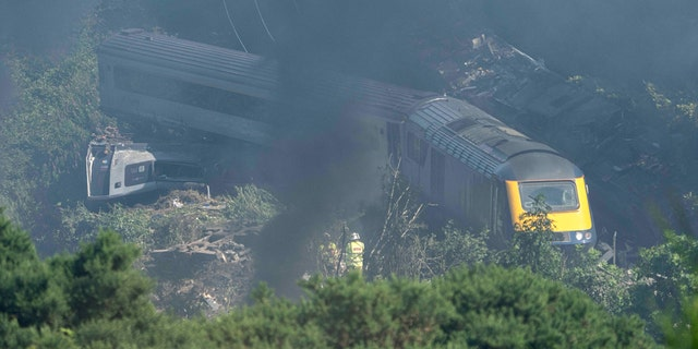 Emergency service personnel were seen at the scene of the train accident near Stonehaven in northeastern Scotland on August 12, 2020. (Photo by Michal Wachucik / AFP via Getty Images)
