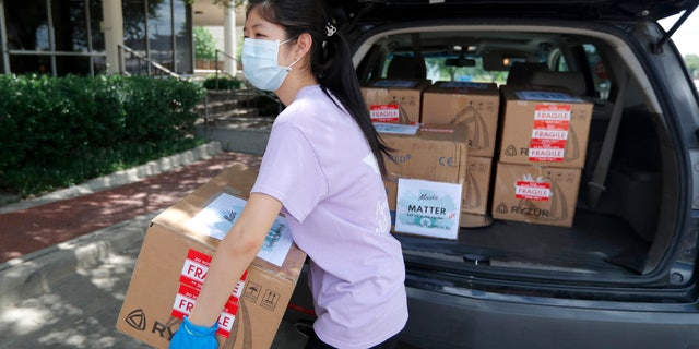Valerie Xu, 15, delivers a donation, boxes of mask to UT Southwestern Medical Center in Dallas, Friday, June 5, 2020. Xu is among teens across the U.S. who decided to take action as the coronavirus pandemic took hold, doing everything from delivering groceries to older people to offering online tutoring, to emailing sick children and to raising money to help feed the hungry.