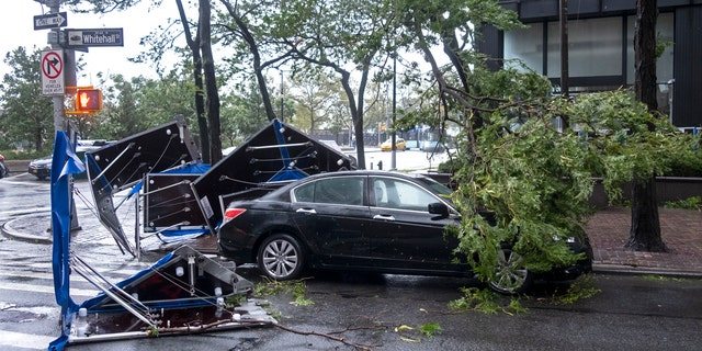 Damage is seen Tuesday, Aug. 4, 2020 in lower Manhattan as Tropical Storm Isaias moved past New York.