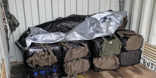 Some of the 28 bags of cocaine recovered near the crash site. (Australian Federal Police.)