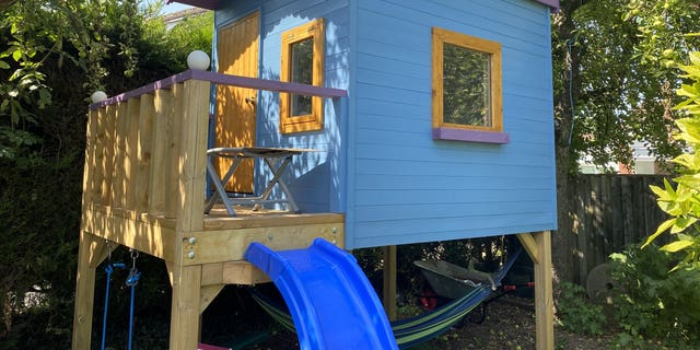 The eight-foot by six-foot playhouse was built in Jason Kneen'sgarden during lockdown. (Credit: SWNS)