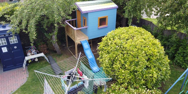 A child's playhouse was listed on Airbnb as a joke by dad-of-five, Jason Kneen, but it was actually booked. (Credit: SWNS)
