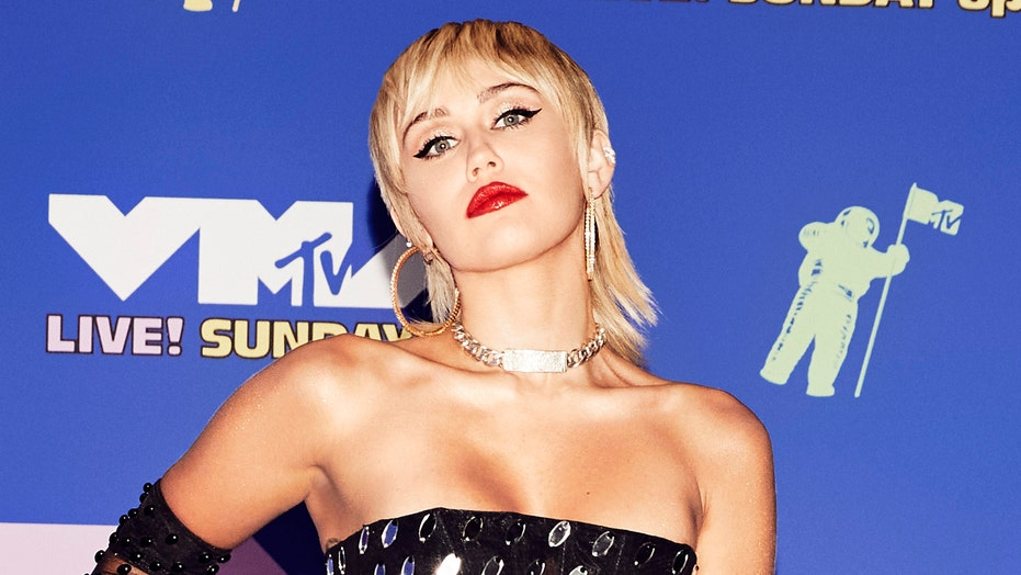 2020 Mtv Vmas Miley Cyrus Dazzles In Sparkling Sheer Dress Swings On Disco Ball During Performance Fox News