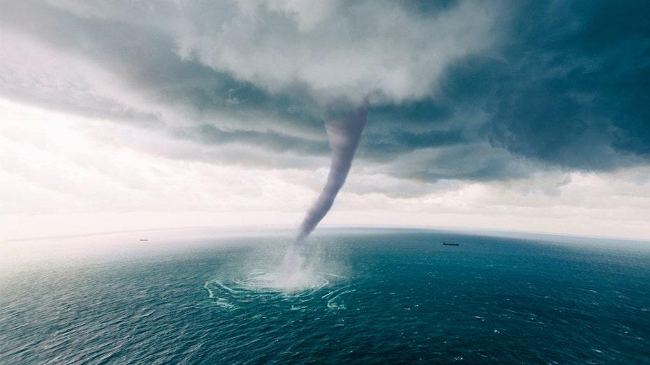 Florida tornado flips cars, shears rooftops, downs trees