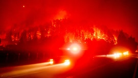 Wildfire-plagued West faces more heat as stormy conditions head East