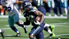 Seahawks' Chris Carson hurts leg after 'gator roll' tackle, Cowboys defensive lineman may face fine