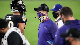 Ravens' John Harbaugh ignites social media criticism for yelling at referee without face covering