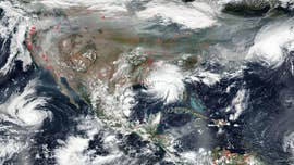 Hurricanes and fires across US revealed in NASA satellite image