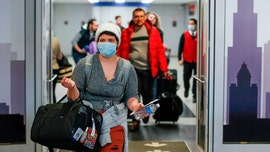U.S. to end enhanced screening program for arriving international travelers, CDC confirms