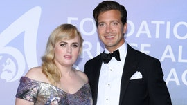 Rebel Wilson shows off weight loss in stunning dress alongside rumored new boyfriend Jacob Busch