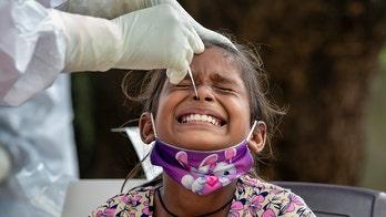 India's coronavirus cases surpass 5 million, outbreak still soaring