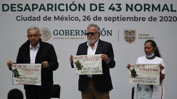 Mexican authorities issue warrants for military, police allegedly linked to disappearance of 43 students