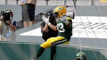 Jones' big day helps Packers beat Lions 42-21 in home opener