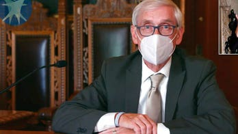 Wisconsin governor urges GOP to wear coronavirus masks as cases surge