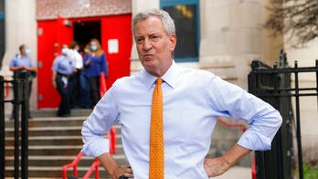 New York City Mayor Bill de Blasio says NYPD officers not wearing masks should face 'penalties'