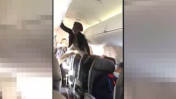 Woman's profanity-filled meltdown on flight to Detroit caught on camera