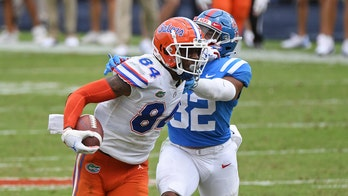 No. 5 Florida beats Ole Miss 51-35 in Kiffin's debut