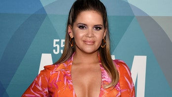 Maren Morris radiates in orange bikini during tropical getaway: 'Tan almost everywhere'