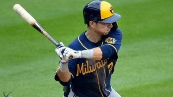 Braun 350th career HR, later plunked; Brews, Cards split DH