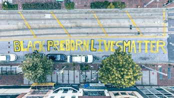 Police allow anti-abortion students to paint 'Black Preborn Lives Matter' outside Planned Parenthood in Baltimore