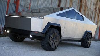 Tesla fan turns Ford F-150 Raptor into Cybertruck