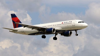 Delta flight returns to gate after woman refuses to wear mask