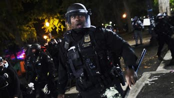 Portland protests: police arrest 30 over weekend as governor calls for review