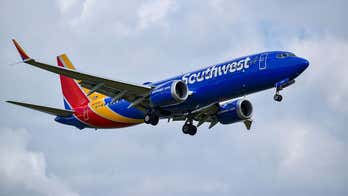 Woman screams when asked to exit Southwest Airlines flight, viral video shows
