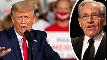 Trump slams Woodward, tells Hannity he didn't want to 'scare people' about virus