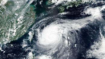 Typhoon Maysak sweeps southern Japan, heads to South Korea