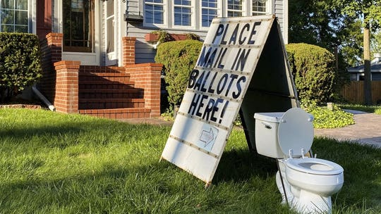 Michigan anti-absentee ballot yard display reported to police