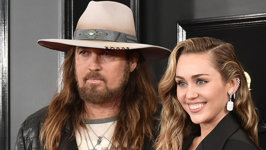 Miley Cyrus says dad Billy Ray Cyrus is to blame for head injury at age 2