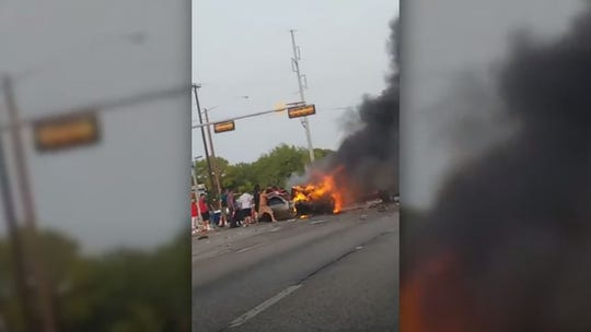 Dallas police, bystanders pull man from burning car after six-vehicle crash, bodycam video shows