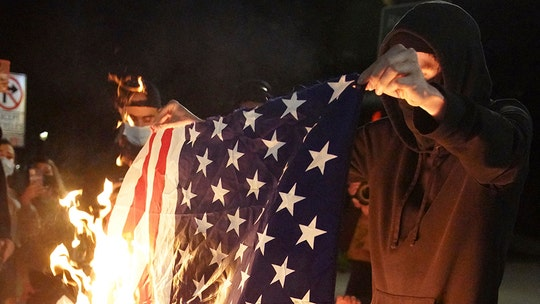Portland unrest prompts arrests; objects thrown at officers, flag burned: reports